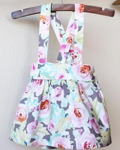 I dont know if there is anything cuter than a Suspender Pinafore Dress. This floral piece is perfect for Spring and Summer. Put a little Peter Pan collared shirt under this with some knee highs and youll be Easter ready. (Insert Heart Eyes Emoji) This is a no-fuss piece that is easy to slip