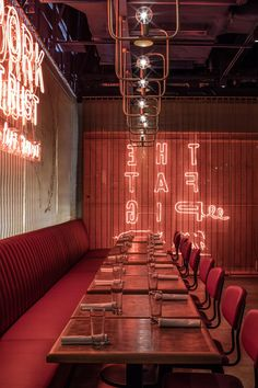 London-based architecture and design practice Michaelis Boyd has completed the design of The Fat Pig by Tom Aikens, creating a mood-lit clubby space filled with leather banquettes, and globed chandeliers.