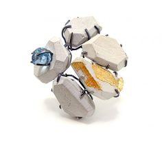 "Tara Locklear, ""Iconic Interpretation Brooch,"" 2012. Cement, reclaimed glass, sterling silver, faux gold leaf."