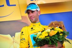 Stage 13: Saint-Étienne - Chamrousse 197.5km - Vincenzo Nibali (Astana) on the podium defending his yellow jersey& collecting what must be a record 12th Lion! Photo credit © Fotoreporter Sirotti