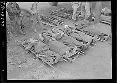 Wounded Marines waiting to be transported to Guam, Iwo Jima, Mar 1945