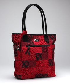 """Diamonds might be a girl's best friend, but there's always a special place in her heart for handbags. This timeless tote in particular had us at """"hello"""" with its pretty print and solid stitching. With cotton fabric and a spacious interior only adding to the amenities, it took all our strength not to swoon.12.5'' W x 14'' H x 4"""" D100% cotton"""
