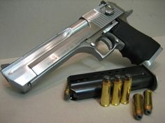 The 50 Cal Desert Eagle always gets peoples Attention !!
