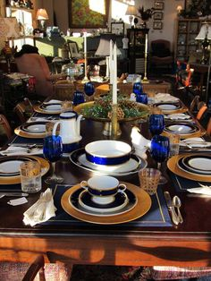 A classic combination of navy and hints of orange make for a beautiful table.