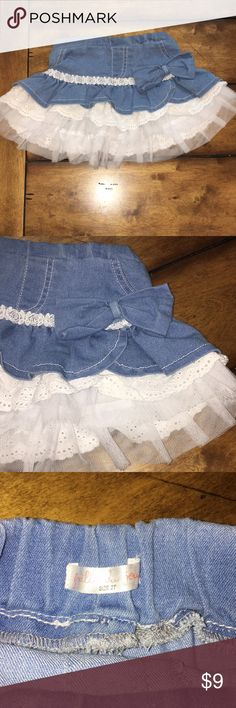 Denim skirt with white lace Denim skirt with white lace and white tulle. Adorable on! In excellent condition Bottoms Skirts
