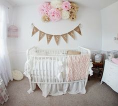 gold pennat flag with name above crib