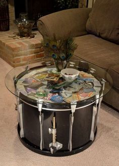 Bass drum to coffee table/concert ticket display. We would need a very long table for the amount of tickets we have lol Bass drum to coffee table/concert ticket display. We would need a very long table for the amount of tickets we have lol Drum Coffee Table, Drum Table, Glass Table, Drum Chair, Music Furniture, Diy Furniture, Concert Ticket Display, Concert Tickets, Ticket Stubs