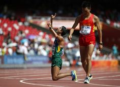 Caio Bonfim of Brazil (L) kneels at the finish line as Cai Zelin of China walks past after the men's 20 km race walk final at the 15th IAAF World Championships at the National Stadium in Beijing, China August 23, 2015. REUTERS/Lucy Nicholson