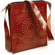 Brown camel leather cross body bag handmade in India.  Find out more at... http://www.thefairtradestore.co.uk/fair-trade-bags/fair-trade-brown-camel-leather-cross-body-bag/prod_589.html  #Fairtrade #Bags #Handmade # India #Leather