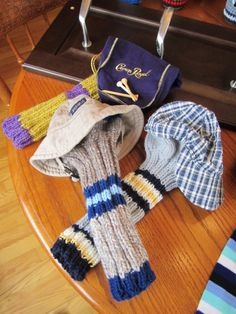 """Caddyshack Creative""  Head Covers and Golf Head Racks by Morgan and Lori.   See ravelry.com Lorisav or visit Ferns GC in Markdale, ON."