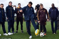 Tottenham stars Erik Lamela and Kieran Trippier try their hand at Aussie Rules during visit to Hawthorn Hawks