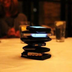 "Everyone puts their phones in the middle of the table. Whoever cracks first by touching their phone, pays for the entire meal. The purpose of the game was to get everyone off their phones, away from twitter, facebook, texting, etc and to encourage conversations. In other words, help cure the ""Anti-Social Social Media Craziness."""