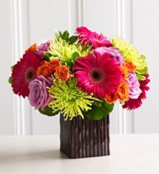 I love that they included spider mums and some small orange roses with the Gerbera daisies!