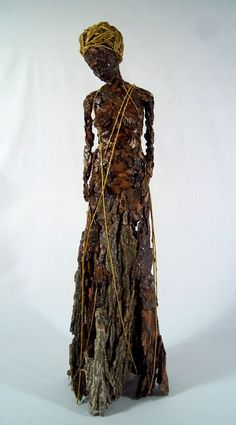 made of tree bark these figures are meant to represent some of the individual characteristiscs shared by trees and humans... in this case Weeping. Not quite a cage doll but reminds me of one. http://www.beckygrismer.com/weep.html