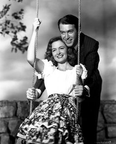 "Jimmy Stewart and Donna Reed  -  ""It's a Wonderful Life"" (1946) - An angel helps a compassionate but despairingly frustrated businessman by showing what life would have been like if he never existed."