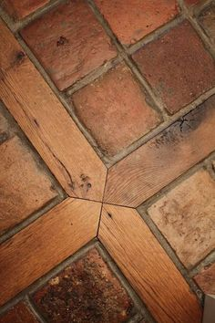 Reclaimed antique terracotta tile with wood inlay. Lovely! #flooringideas