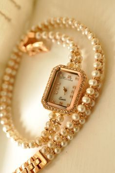 temperament bracelet wristwatch  - http://zzkko.com/n140611-TAR-Recommended-2-013-The-new-aestheticism-temperament-diamond-studded-natural-pearls-bracelet-wristwatch-female-fashion-table.html $22.56