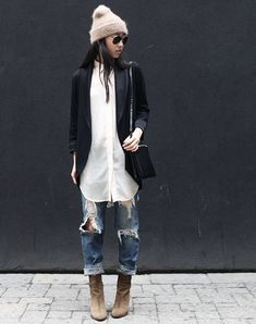 long black blazer. white shirt. ripped boyfriend jeans. boots. hat.