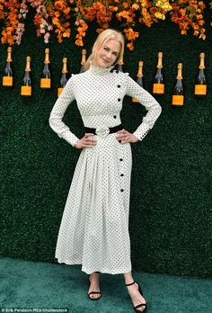 Under cover star: Nicole Kidman made sure her pale skin wasn't exposed to the sun in a pol...