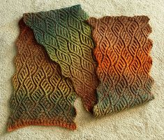 Ravelry: Sushi Ushi Scarf pattern by Nancy Marchant -  also in one of her books, see ravelry for more.