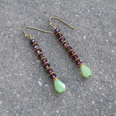 Slender and lean, boho chic crystal and African trade bead earrings. With hypoallergenic stainless steel ear hooks (antique brass colored) for easy and comforta