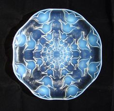 CAMPANULES' ~ A RARE RENE LALIQUE CHARGER  'Campanules' is a rare and iconic charger design of Rene Lalique, first created in 1932.    This charger exhibits the deep blue opalescence with good orange 'fire' that is much sought after in the Rene Lalique production.    C1932