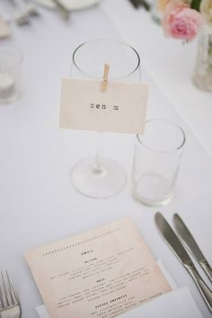 place card clipped to a wine glass with a mini clothes pin... perfect for dinner served family-style or any table layout with limited space!
