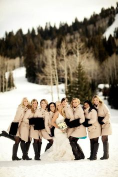 Winter wedding bridesmaids with matching coats, muffs, and boots