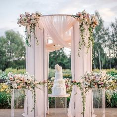 // Give your wedding cake a touch of blossom pink with spring inspired theme decor at the venue, full of fresh flowers and pastel drapes! For wedding & event decor, schedule your bookings today with us at Spara Events. Tulle Wedding Decorations, Ceremony Decorations, Wedding Ceremony Flowers, Bridal Flowers, Arch Flowers, Ceremony Arch, Wedding Receptions, Wedding Arrangements, Flower Arrangements