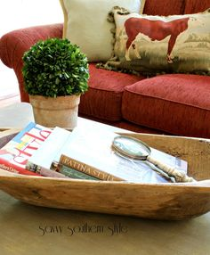 Love the books in an old dough bowl with a Magnify glass