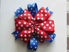 DIY Pinwheel bow I haven't found the perfect center quite yet but isn't it the cutest? I could kick myself for not seeing how easy it was before!!! Different size ribbon and desired lo…