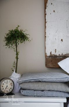 topiary, weathered wood and vintage fabrics