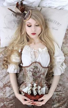 Steampunk Sleeping Beauty. For Steampunk costume tutorials, fashion inspiration, fashion guide & a calendar of Steampunk events, visit SteampunkFashionGuide.com