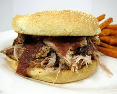 Slow Cooker Coca-Cola Pulled Pork with Coca-Cola BBQ Sauce - only 2 ingredients for the pulled pork! SO good. You have to make the BBQ sauce to go with this. Simple recipe, but SOOOO yummy!