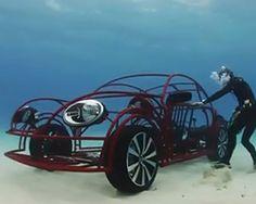 volkswagen beetle mobile shark cage cruises the ocean floor.