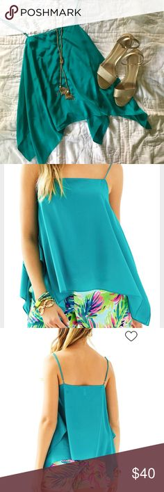Lilly Pulitzer Kimi silk top. sm The solid Kimi Top is a strappy camisole with a waterfall hem. This top looks great with printed shorts or white jeans for a night out with friends. Worn once and dry cleaned after. Lilly Pulitzer Tops Tank Tops