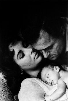 Liz Taylor with one of her husbands and her baby