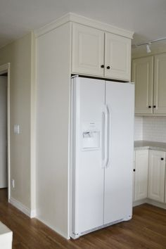 Boxing in Fridge with Cabinetry - Momplex Vanilla Kitchen - Ana White USE THE wood we got and buy a cabinet or buy a white end piece and buy a white cabinet Diy Projects Kitchen Cabinets, Diy Kitchen, Kitchen Furniture, Furniture Stores, Furniture Outlet, Cabinet Furniture, Discount Furniture, Online Furniture, Luxury Furniture