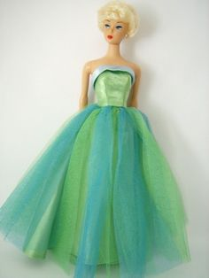 Barbie looks an absolute knockout in her Senior Prom dress, tailored in luxurious sea green and ice blue satin. The full sea green satin skirt is overlaid with layers of sea green and ice blue tulle, just gobsmackingly stunning.