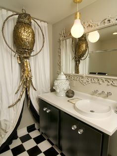 I'm not quite sure what that gold thing is having up, but I LOVE the molding around the mirror!