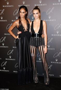 Getting in on the cleavage action: Joan Smalls also flashed some cleavage in a black dress with plunging neckline