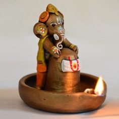 Get this unique terracotta copper finish baby Ganesha holding Lord Shiva in pound. The Ganesha and the Lord Shiva Idol has been handpainted with multiple colours to give it a class and sheen. -www.cooliyo.com