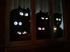 easy cardboard silhouettes with eyes that appear to follow you.  (xmas lights, cereal boxes, cardboard, white paper, black paint.)