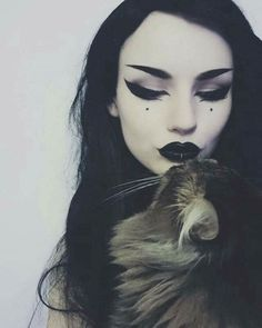 Goth with a kitty, think you would see more cats with Goths