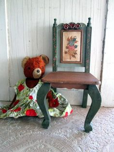Here is a sweet little shabby doll display chair. It is all wood and hand painted. It measures 15 tall and 7 wide. It is in excellent vintage