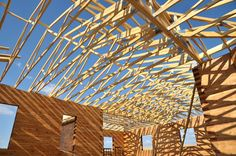 Photo about Structure of a wooden house under construction, in French. Image of rafter, natural, window - 13241824 House Under Construction, Camping Resort, Eco Green, Concrete Structure, Wooden House, Green Building, Building Materials, Architecture, Organic