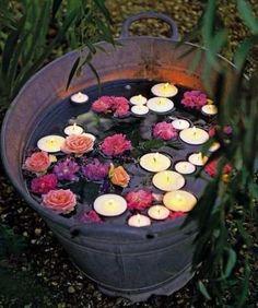 Floating candles and flowers: Summer Garden Wedding Decor Idea