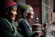 Elderly women sit in Lo Manthang to spin prayer wheels and pray together. This is a daily communal ritual for most retired Loba. (Taylor Weidman/The Vanishing Cultures Project) #