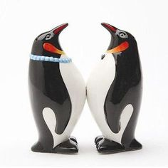 """We all know that penguins mate for life, but our ceramic (4"""" tall) Mr. and Mrs. Penguin Salt and Pepper Shakers have another reason to stick together, they each have magnets on their bellies to keep t"""
