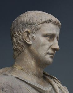 Marble portrait of the Roman emperor Claudius (reign A.D. 41-54). The portrait has been restored (including the nose) and has been attached to a togate headless statue (note the break at the line of the neck). Vatican Museums inv. 2221.